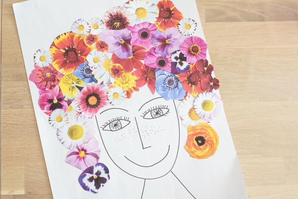 activité manuelle, un visage aux cheveux fleuris. Collage